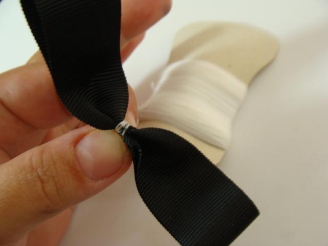 aperte-o-meio-do-laço-e-preda-com-a-linha